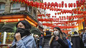 China to extend Lunar New Year holidays as it struggles to contain deadly virus