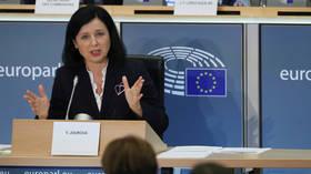 EU commissioner tells Poland 'door for dialogue' on judicial reform is open