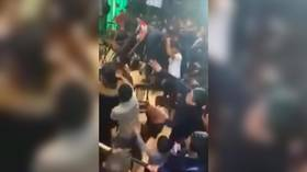 Chairs & bottles fly as Moscow MMA event turns into mass brawl (VIDEO)