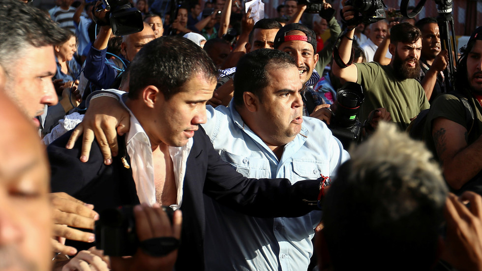 'Murderer!' Protests and fights erupt as Guaido arrives at Venezuelan airport, gets booed and DOUSED with water (VIDEOS)