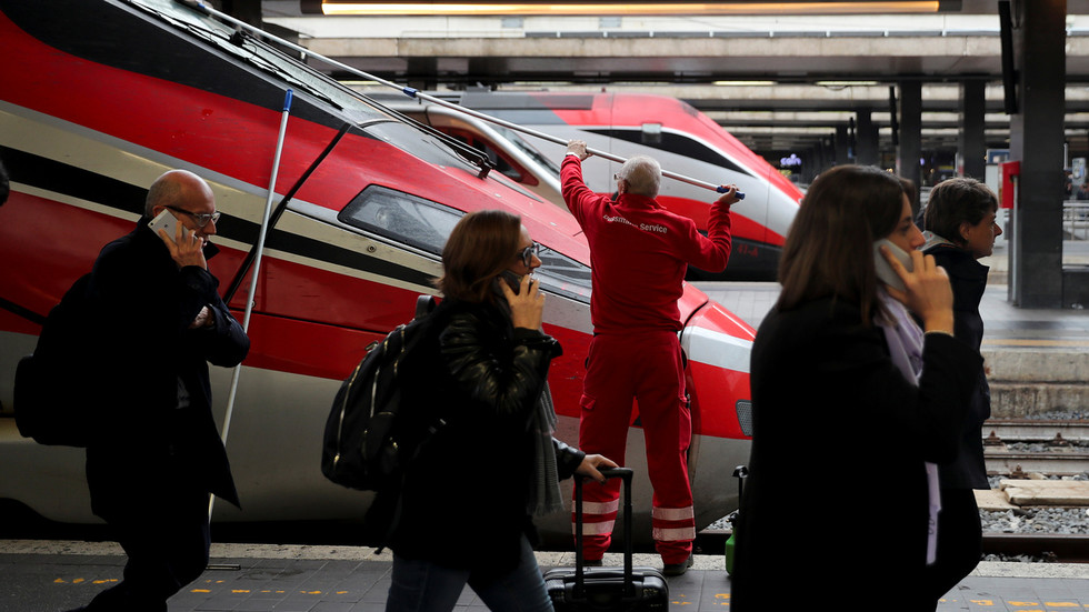 WATCH: Onlookers flee as suspected coronavirus patient wheeled through Florence train station