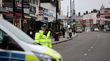 Police is seen near a site where a man was shot by armed officers in Streatham, south London, Britain, February 2, 2020. © Reuters / Antonio Bronic