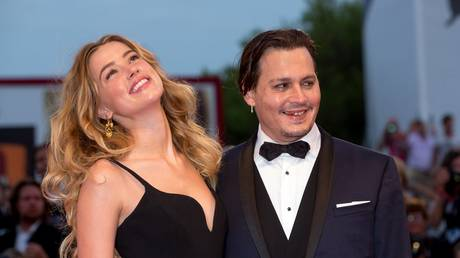 FILE PHOTO: Johnny Depp and Amber Heard attending the 2015 Venice Film Festival © Global Look Press / Hubert Boesl