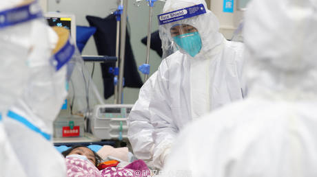 Medical staff attending to a patient, Central Hospital of Wuhan January 25, 2020