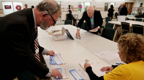 Iowa Caucus precinct workers count and tally Iowa Democratic Caucus votes by hand