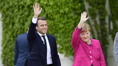 German Chancellor Angela Merkel and French President Emmanuel Macron © AFP / Tobias SCHWARZ
