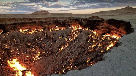 "FILE PHOTO: The Darvaza gas crater, also known as ""The Door to Hell,"" Karakum Desert, Turkmenistan © Gobal Look Press / Daniel Kreher"