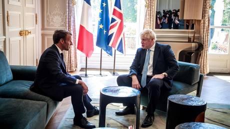 French President Emmanuel Macron and British Prime Minister Boris Johnson © AFP / POOL / Christophe PETIT TESSON