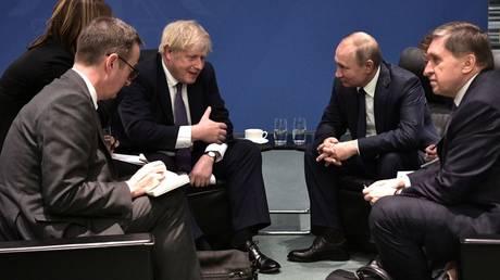 Russia's President Vladimir Putin and Britain's Prime Minister Boris Johnson meet on sideline of the Libya summit in Berlin. © Reuters / Aleksey Nikolskyi / Kremlin