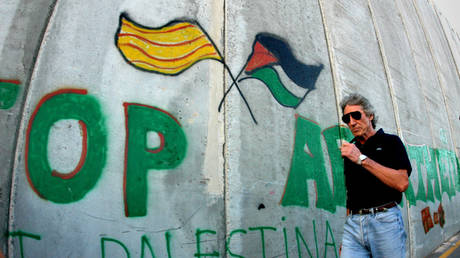 FILE PHOTO: Roger Waters walks along the controversial Israeli barrier in the West Bank city of Bethlehem