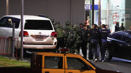 Thai security forces move to enter the Terminal 21 shopping mall following a gun battle, to try to stop a soldier on a rampage after a mass shooting, Nakhon Ratchasima, Thailand February 9, 2020.