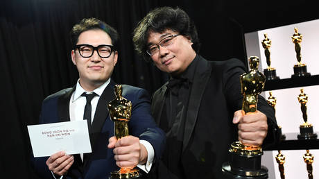 "Bong Joon Ho and Han Jin Won hold their Oscar statues for Original Screenplay for ""Parasite"" at the 92nd Academy Awards in Hollywood, Los Angeles, California,  February 9, 2020."