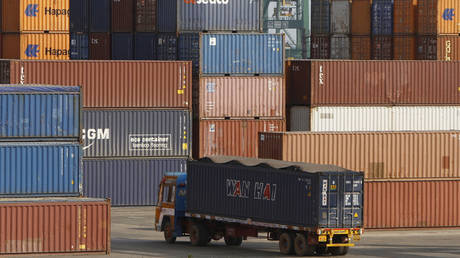 FILE PHOTO: A truck ferries a shipping container at a port in the southern Indian city of Chennai.