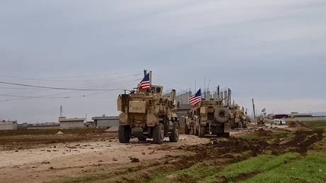 A convoy of US military vehicles moves in the village of Khirbet Amo, near Qamishli, Syria February 12, 2020.