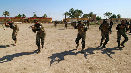 FILE PHOTO: Members of the paramilitary Popular Mobilisation Forces (PMF) take part in military training at their camp in Basra, Iraq.