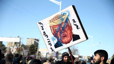 An Iranian holds a placard of the U.S. President Donald Trump at commemoration of 41st anniversary of the Islamic revolution in Tehran