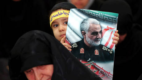 FILE PHOTO: People gather in Tehran to mourn during a forty-day memorial for Iranian Quds Force commander Qassem Soleimani, who was killed in a US air strike in January.