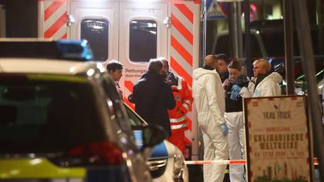 Forensic experts are seen outside a shisha bar after a mass shooting in Hanau near Frankfurt, Germany, February 20, 2020.