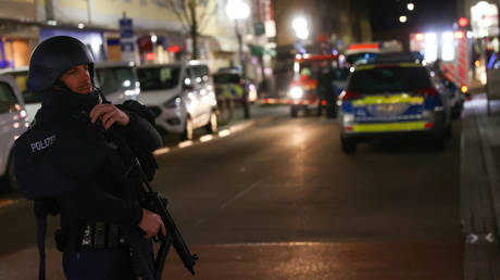 A police officer secures the area around the scene of a mass shooting in Hanau near Frankfurt, Germany, February 19, 2020.