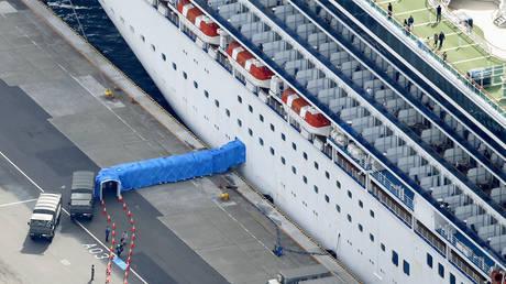 Passengers disembarking from the Diamond Princess cruise ship docked at Yokohama Port