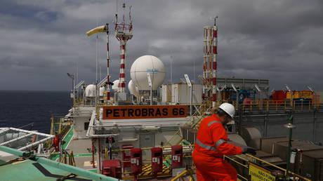 A worker walks inside the Brazil's Petrobras P-66 oil rig in the offshore Santos Basin in Rio de Janeiro, Brazil. @ REUTERS / Pilar Olivares
