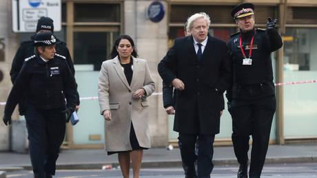 British Prime Minister Boris Johnson and Home Secretary Priti Patel © REUTERS / Simon Dawson / Pool