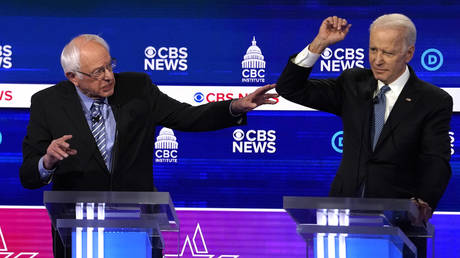 Democratic 2020 US presidential candidates Senator Bernie Sanders and former Vice President Joe Biden debate at the tenth Democratic presidential debate at the Gaillard Center in Charleston, South Carolina, February 25, 2020.
