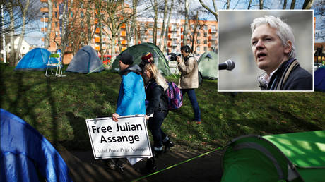 Supporters of Julian Assange (inset) outside Woolwich Crown Court this week. © REUTERS/Henry Nicholls