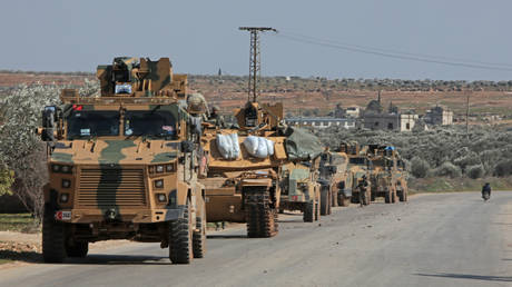 FILE PHOTO: A convoy of Turkish military vehicles drives east of Idlib city in northwestern Syria on February 20, 2020.