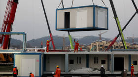 China's first 1,000-bed hospital to treat coronavirus patients built within DAYS (VIDEO)