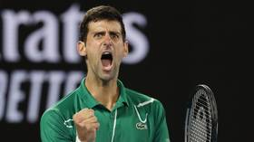 Wizard of Oz: Djokovic stages fightback to beat Thiem and win record-extending EIGHTH Australian Open
