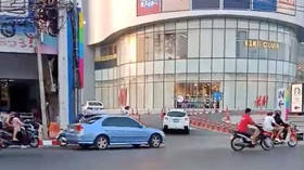 WATCH people fleeing Thai shopping mall in panic as shooter takes hostages, kills 30
