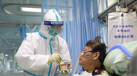 China coronavirus death toll soars to 813 with 37,000+ cases worldwide
