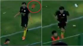 Sticking the boot in: Tunisian footballer sent off for attacking cheeky ball boy who chucked his boot into crowd (VIDEO)
