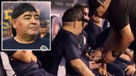 Maradona handed mystery package on the bench as coaches appear to block cameras during match (VIDEO)