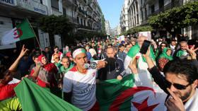 Algerian president honors 'smile revolution' protest on 1st anniversary