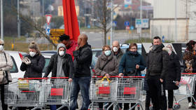 Shops stripped bare in scenes reminiscent of 'zombie apocalypse' as coronavirus fears sweep Italy (VIDEOS)
