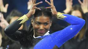 Perfect 10! Gymnast Nia Dennis floors the competition with incredible Beyonce-inspired routine (VIDEO)