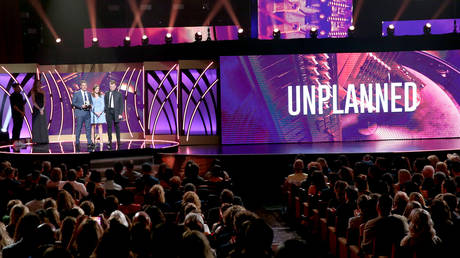 """FILE PHOTO: Actress Ashley Bratcher and  """"Unplanned"""" co-stars accept a film award onstage during the 7th Annual K-LOVE Fan Awards at The Grand Ole Opry House in Nashville, Tennessee."""