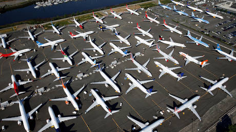 FILE PHOTO: Dozens of grounded Boeing 737 MAX aircraft are seen parked at Boeing Field in Seattle.
