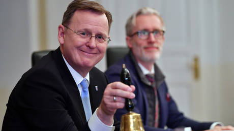 FILE PHOTO: Thuringia's newly elected Prime Minsiter Bodo Ramelow of the Left Party (Die Linke) rings the bell at the first cabinet meeting in Erfurt, Germany, on March 4, 2020.
