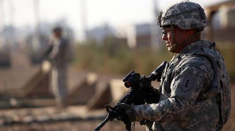 An American soldier stands guard at the Taji base complex