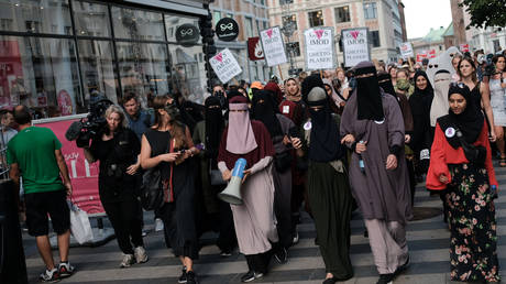 Protest in Aarhus, Denmark, 2018 in defiance of the Danish Governments ban on the burka and niqab. © Getty Images/NurPhoto/Aleksander Klug