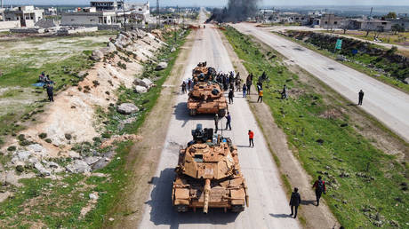 Turkish tanks are seen patroling M4 highway in Syria's province of Idlib on March 15, 2020.