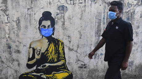 Street art of Buddha wearing a facemask, in Mumbai on March 16, 2020.