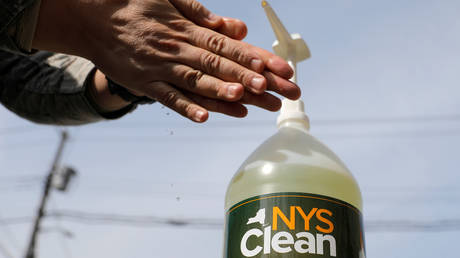 A member of the New York Army National Guard uses hand sanitizer, March 18, 2020.