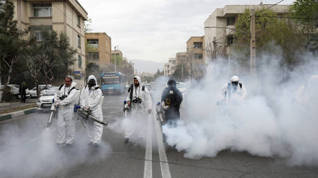 Members of firefighters disinfect the streets, ahead of the Iranian New Year © WANA /Ali Khara via REUTERS