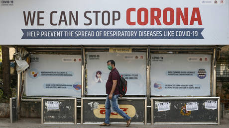 A man walks past a bus stop in Mumbai, India, March 18, 2020