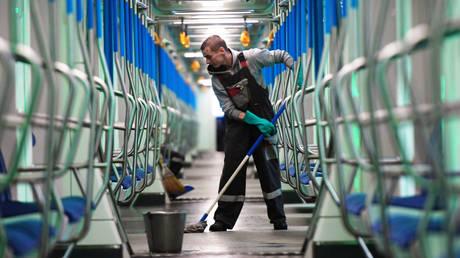 A worker disinfects a Moscow metro car. © Sputnik / Kirill Kalinnikov