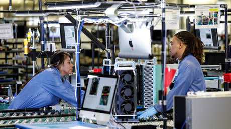 Flextronics International Apple factory employees work on Apple Mac Pro computer assembly in Austin, TX, US
